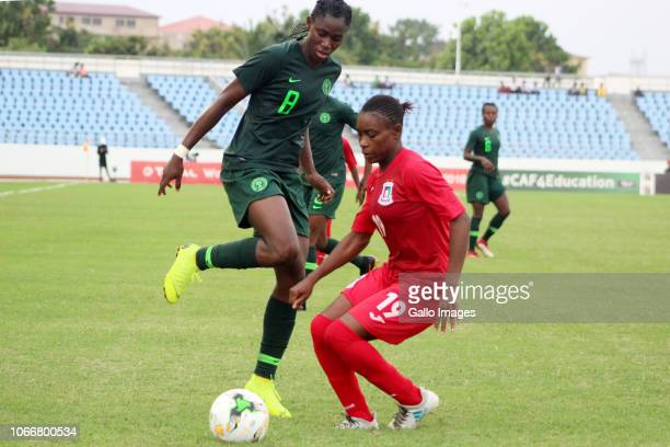 Asisat Oshoala of Nigeria and Cecilia Akeng Nengono of Equitorial Guinea in action during the 2018 TOTAL African Womens Cup of Nations match between...