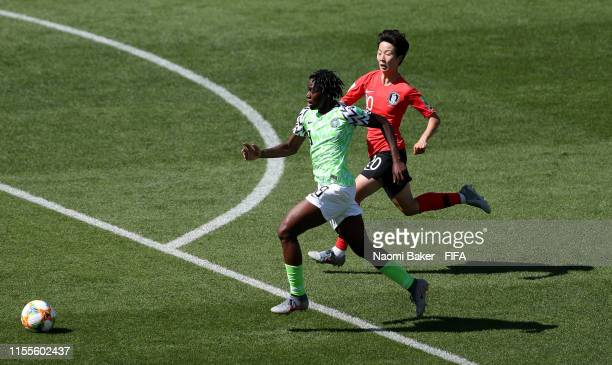 Asisat Oshoala of Nigeria battles for possession with Hyeri Kim of Korea Republic during the 2019 FIFA Women's World Cup France group A match between...
