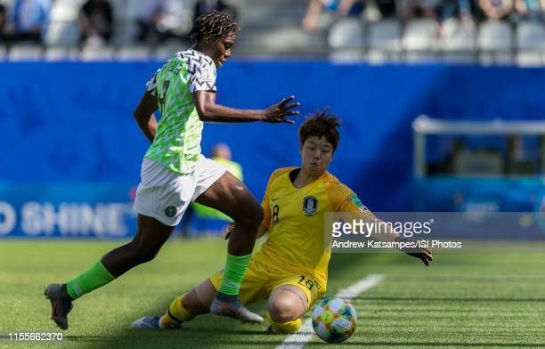 Asisat Oshoala of Nigeria beats goalkeeper Minjung Kim of the Korea Republic during the 2019 FIFA Women's World Cup France group A match between...