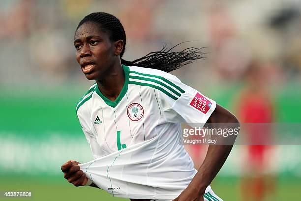 Asisat Oshoala of Nigeria celebrates a goal during the FIFA U20 Women's World Cup Canada 2014 Semi Final match between Korea DPR and Nigeria at...