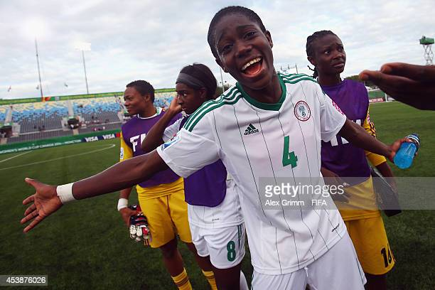 Asisat Oshoala of Nigeria celebrates after the FIFA U20 Women's World Cup Canada 2014 Semi Final match between Korea DPR and Nigeria at Moncton...
