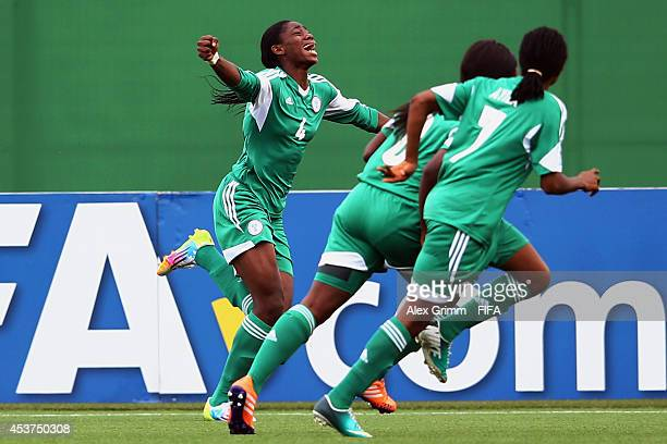 Asisat Oshoala of Nigeria celebrates her team's first goal during the FIFA U20 Women's World Cup Canada 2014 Quarter Final match between Nigeria and...