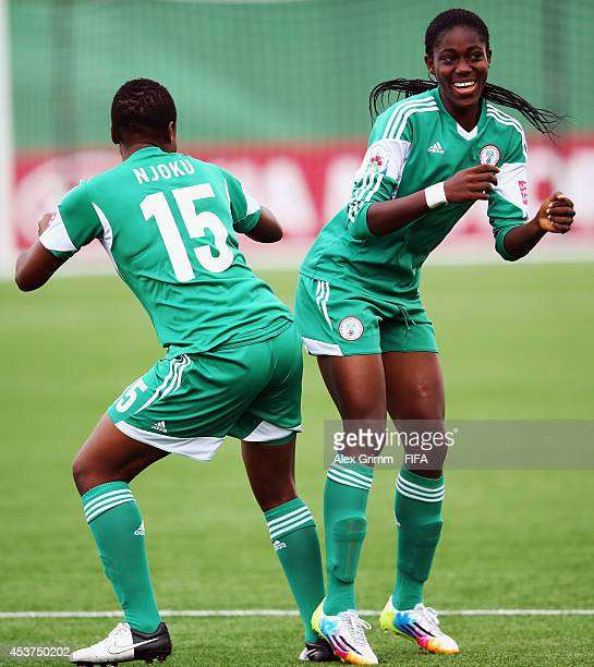 Asisat Oshoala of Nigeria celebrates her team's first goal with team mate Ugo Njokuduring the FIFA U20 Women's World Cup Canada 2014 Quarter Final...