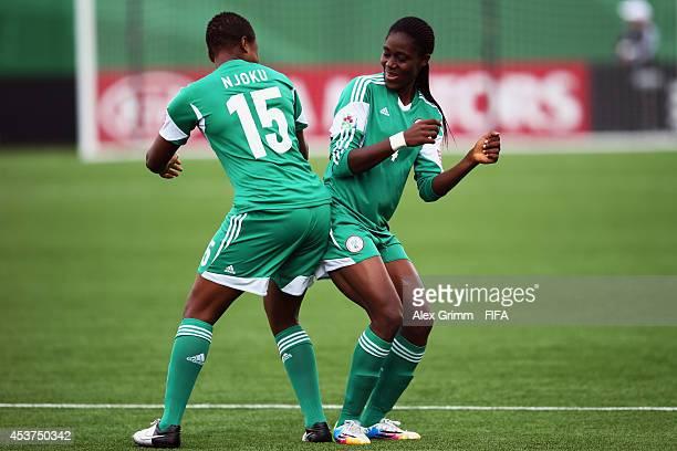 Asisat Oshoala of Nigeria celebrates her team's first goal with team mate Ugo Njokuduring the FIFA U20 Women's World Cup Canada 2014 Quarter Final...