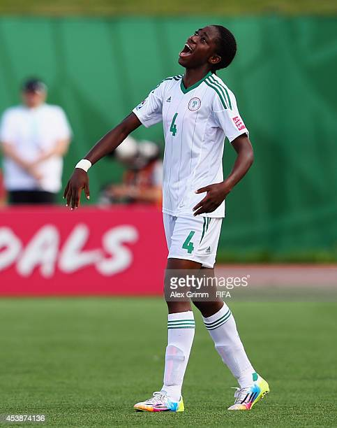 Asisat Oshoala of Nigeria celebrates her team's fourth goal during the FIFA U20 Women's World Cup Canada 2014 Semi Final match between Korea DPR and...