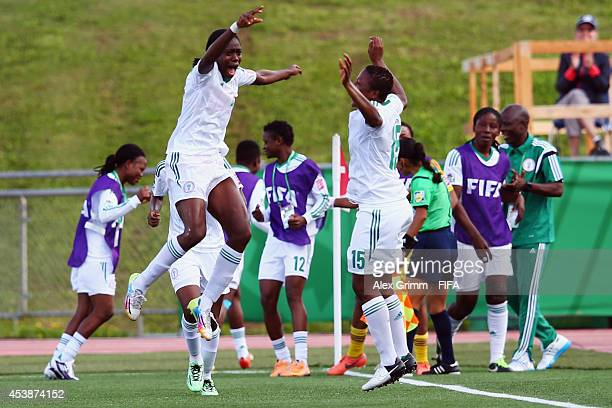 Asisat Oshoala of Nigeria celebrates her team's fourth goal with team mates during the FIFA U20 Women's World Cup Canada 2014 Semi Final match...