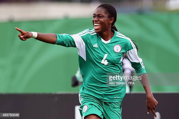 Asisat Oshoala of Nigeria celebrates her team's second goal during the FIFA U20 Women's World Cup Canada 2014 Quarter Final match between Nigeria and...