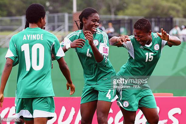 Asisat Oshoala of Nigeria celebrates her team's second goal with team mates Ugo Njoku and Halimatu Ayinde during the FIFA U20 Women's World Cup...
