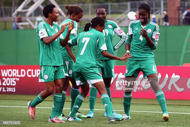 Asisat Oshoala of Nigeria celebrates her team's second goal with team mates during the FIFA U20 Women's World Cup Canada 2014 Quarter Final match...