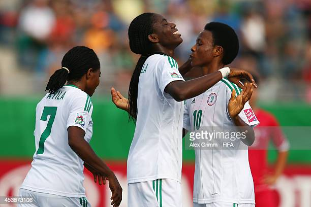 Asisat Oshoala of Nigeria celebrates her team's second goal with team mates Halimatu Ayinde and Loveth Ayila during the FIFA U20 Women's World Cup...
