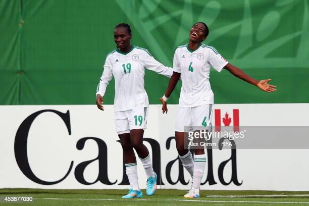 Asisat Oshoala of Nigeria celebrates her team's sixth goal with team mate Chinwendu Ihezuo during the FIFA U20 Women's World Cup Canada 2014 Semi...