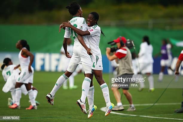 Asisat Oshoala of Nigeria celebrates with Uchechi Sunday after the FIFA U20 Women's World Cup Canada 2014 Semi Final match between Korea DPR and...