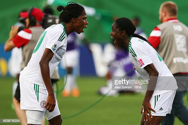 Asisat Oshoala of Nigeria celebrates with Uchechi Sunday after the FIFA U20 Women's World Cup Canada 2014 Semi Final match between Korea DPR and...