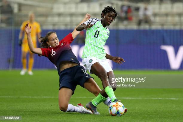 Asisat Oshoala of Nigeria is challenged by Guro Reiten of Norway during the 2019 FIFA Women's World Cup France group A match between Norway and...