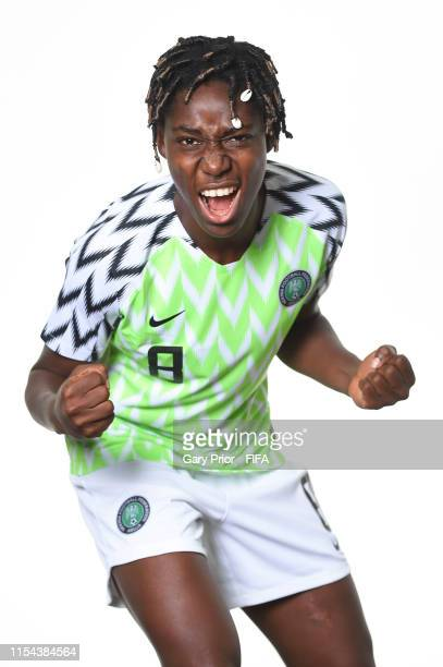 Asisat Oshoala of Nigeria poses for a portrait during the official FIFA Women's World Cup 2019 portrait session at Hotel Mercure Reims Centre...