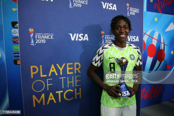 Asisat Oshoala of Nigeria poses with her VISA Player of the Match Award following the 2019 FIFA Women's World Cup France group A match between...