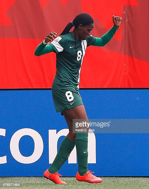 Asisat Oshoala of Nigeria reacts after scoring the second goal against Sweden during the FIFA Women's World Cup Canada 2015 Group D match between...