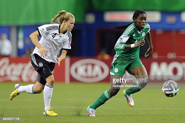 Asisat Oshoala of Nigeria runs with the ball in front of Margarita Gidion of Germany during the FIFA Women's U20 Final at Olympic Stadium on August...