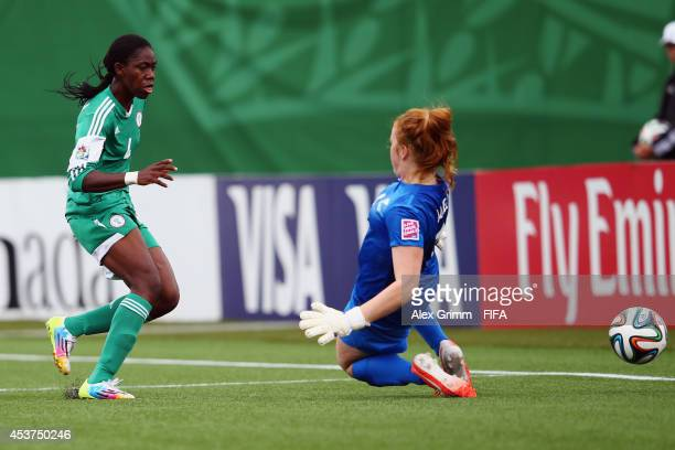 Asisat Oshoala of Nigeria scores her team's second goal against goalkeeper Lily Alfeld of New Zealand during the FIFA U20 Women's World Cup Canada...