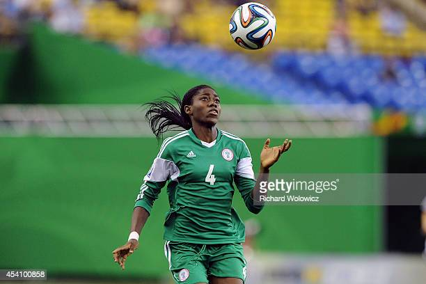 Asisat Oshoala of Nigeria watches the ball descend during the FIFA Women's U20 Final against Germany at Olympic Stadium on August 24 2014 in Montreal...