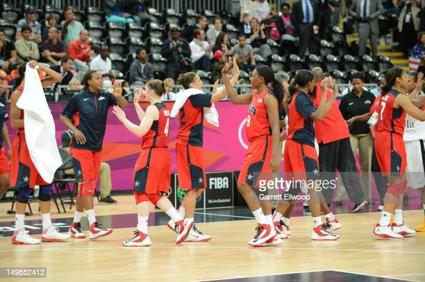 Asjha Jones and Diana Taurasi high five against Angola at the Olympic Park Basketball Arena during the London Olympic Games on July 30 2012 in London...
