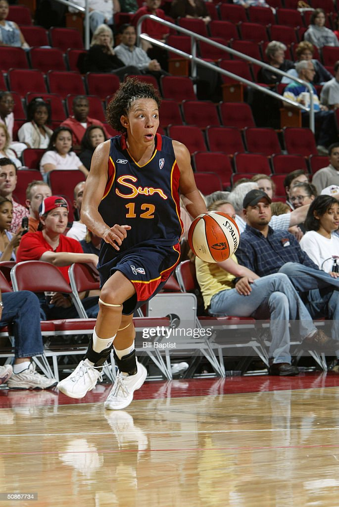 Asjha Jones #15 of the Connecticut Sun dribble drives to the basket against the Houston Comets during the preseason game at Toyota Center on May 11, 2004 in Houston, Texas. The Comets won 84-71.