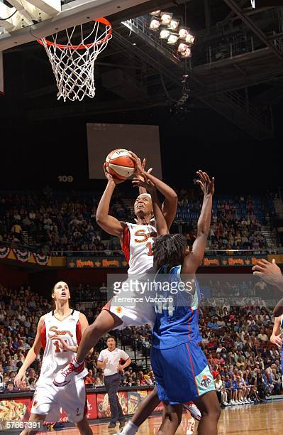 Asjha Jones of the Connecticut Sun goes to the basket against Barbara Farris of the New York Liberty at Mohegan Sun Arena on May 20 2006 in...
