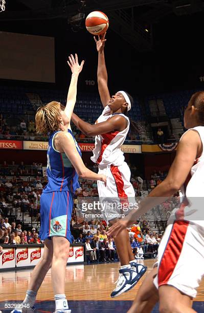 Asjha Jones of the Connecticut Sun goes to the basket against Elena Baranova of the New York Liberty during the game at Mohegan Sun on July 28 2005...