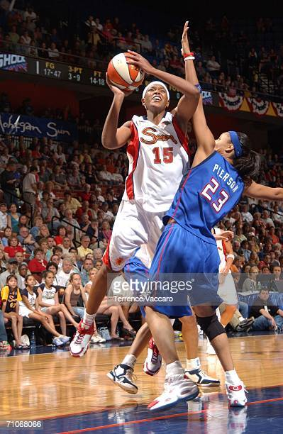 Asjha Jones of the Connecticut Sun goes to the basket against Plenette Pierson of the Detroit Shock at Mohegan Sun Arena on May 27 2006 in Uncasville...