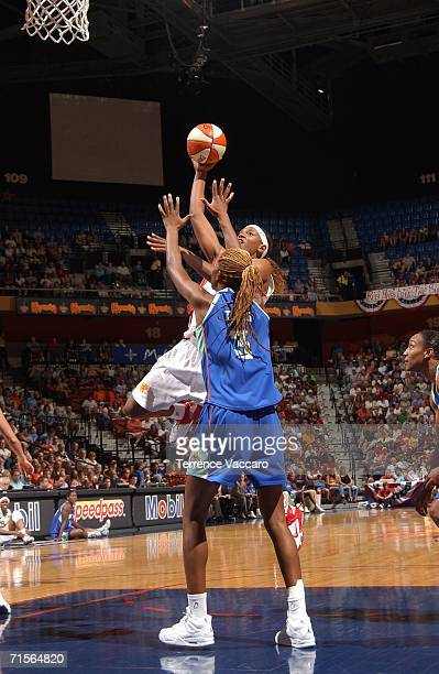 Asjha Jones of the Connecticut Sun shoots against Iciss Tillis of the New York Liberty on August 1 2006 at Mohegan Sun Arena in Uncasville...