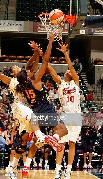 Asjha Jones of the Connecticut Sun shoots over LaToya Bond and Khadijah Whittington of the Indiana Fever at Conseco Fieldhouse on July 5 2008 in...