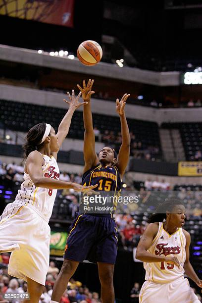 Asjha Jones of the Connecticut Sun shoots over Tammy SuttonBrown of the Indiana Fever at Conseco Fieldhouse on August 28 2008 in Indianapolis Indiana...