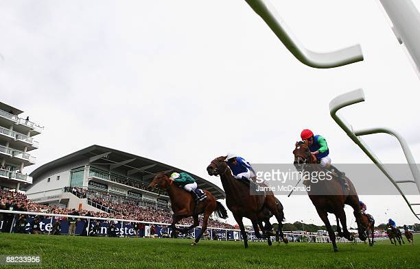 Ask ridden by Ryan Moore wins the Investec Corination Cup run at Epsom Racecourse on June 5, 2009 in Epsom, England.
