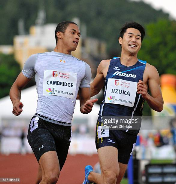 Aska Cambridge and Shota Iizuka of Japan react after competing in the Men's 100m during the International Meeting de Liege on July 13 2016 in Liege...