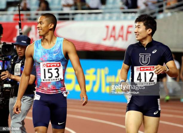 Aska Cambridge and Yoshihide Kiryu react after competing in the Men's 100m semi final during day one of the 101st JAAF Athletics Championships at...