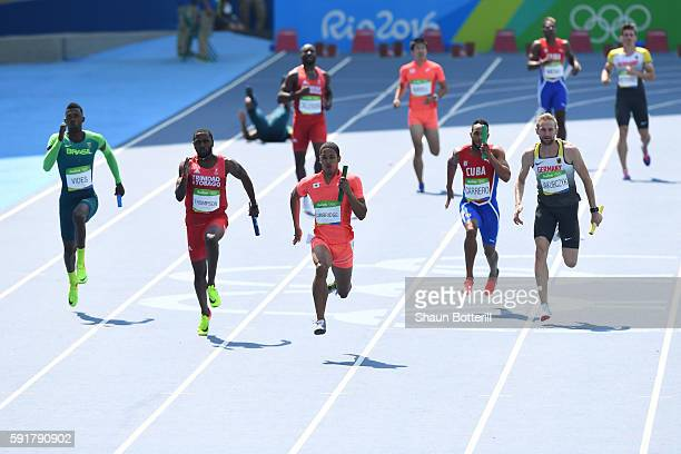 Aska Cambridge of Japan competes in round one of the Men's 4 x 100m Relay on Day 13 of the Rio 2016 Olympic Games at the Olympic Stadium on August 18...