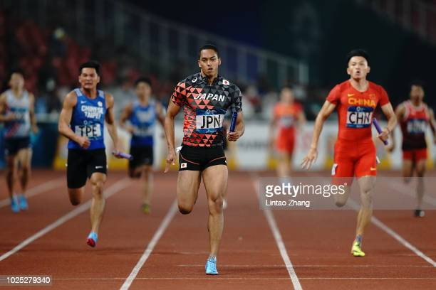 Aska Cambridge of Japan wins the final of the men's 4x100m relay athletics event on day twelve of the Asian Games on August 30, 2018 in Jakarta,...