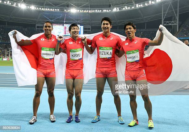 Aska Cambridge Yoshihide Kiryu Shota Iizuka and Ryota Yamagata of Japan celebrate winning the silver medal in the Men's 4 x 100m Relay on day 14 of...