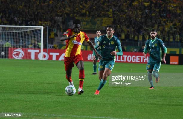 Kabyli Reda ben sayeh and esperance's Kwame bonsu are seen in action during the CAF Champions League 2019 - 20 football match between Esperance...