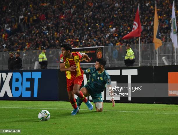 Kabylie Billal Tizi Bouali and esperance's Abderaouf Ben are seen in action during the CAF Champions League 2019 - 20 football match between...
