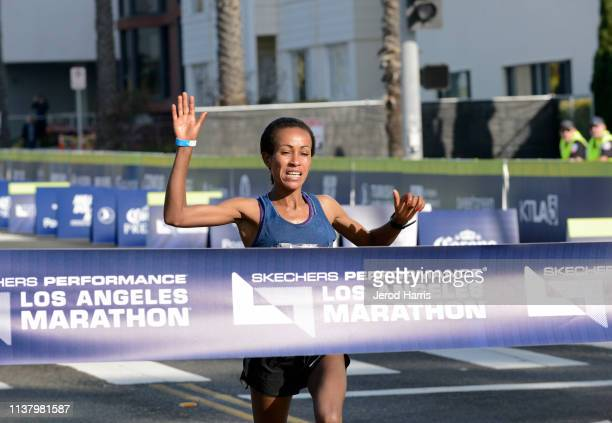 Askale Merachi is the first female runner to cross the finish line the 34th Running Of The Skechers Los Angeles Marathon on March 24 2019 in Los...
