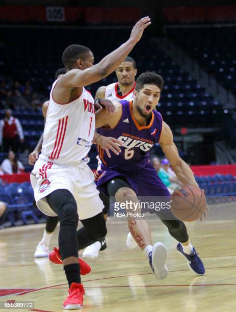 Askia Booker of the Northern Arizona Suns drives the ball on Isaiah Taylor of the Rio Grande Valley Vipers at the State Farm Arena March 19 2017 in...