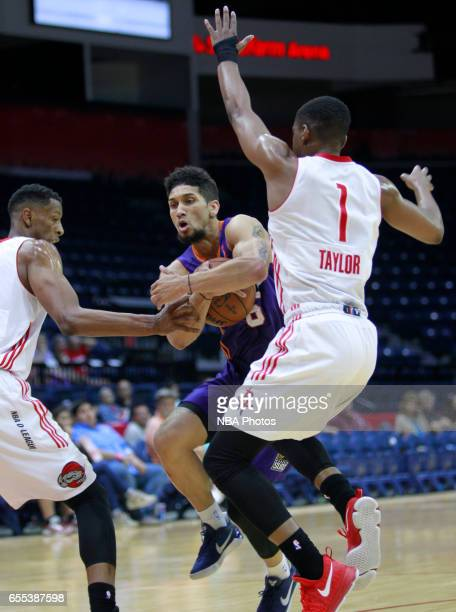 Askia Booker of the Northern Arizona Suns tries to get between Isaiah Taylor right and Troy Williams of the Rio Grande Valley Vipers at the State...