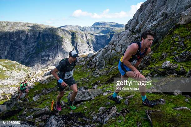 Askild Vatnbakken Larsen followed by Gjermund Nordskar and Tommy Haga on the way up the first climb at Hardangervidda Marathon on September 2 2017 in...