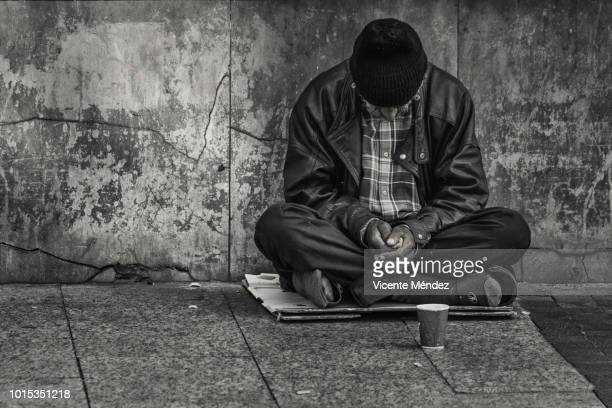 Asking for alms in the street