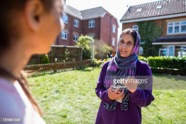 asking her friend for advice - middlesbrough stock pictures, royalty-free photos & images