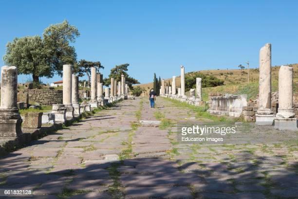 Asklepieion, also spelled Asclepieion, Asclepion, Asklepion, Asclepeion, near Bergama, Izmir Province, Turkey, A visitor strolls along the main...