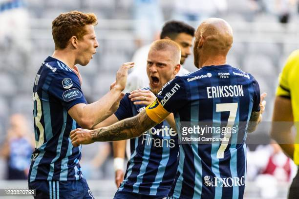 Aslak Witry of Djurgardens IF celebrates scoring a penalty with teammates Magnus Eriksson and Kalle Holmberg during the Allsvenskan match between...