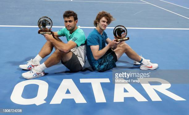 Aslan Karatsev and Andrey Rublev of Russia pose with the trophy after victory in the Final of the Men's Doubles between Marcus Daniell & Philipp...