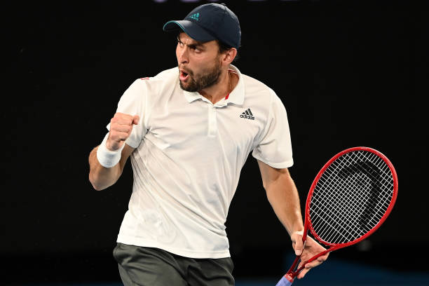 Aslan Karatsev of Russia celebrates a point in his Men's Singles Semifinals match against Novak Djokovic of Serbia during day 11 of the 2021...